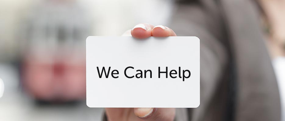 hand holding card saying We can help